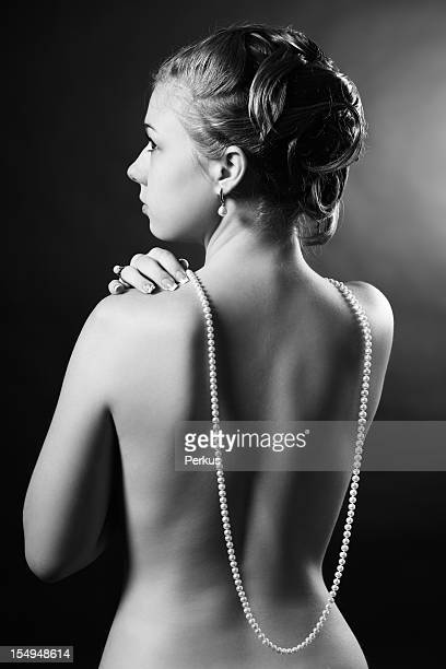 nude young woman with pearl beads