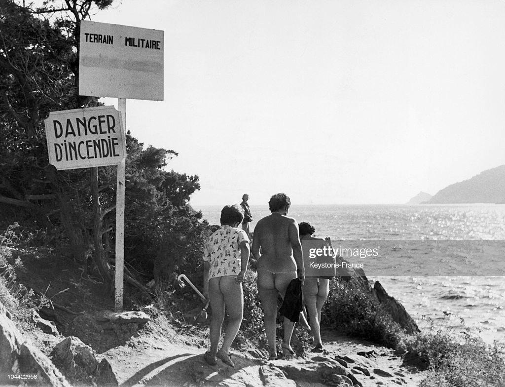 Nudist Zone Nudist Tourists In A Military Zone.
