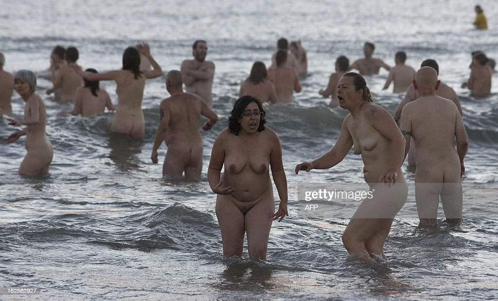 Nudists take part in the North East Skinny Dip at Druridge Bay in Northumberland, at sunrise on September 22, 2012. Over 200 bathers braved the cold in an attempt to break the World Record for the largest skinny-dip. The record still stands at over 400, set at Rhossili Beach in Wales.