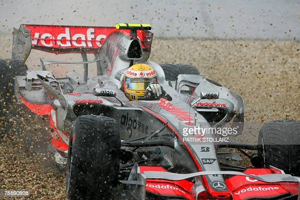 British McLarenMercedes driver Lewis Hamilton spins off the track as it stars to rain at Nuerburgring racetrack 22 July 2007 in Nuerburgring at start...