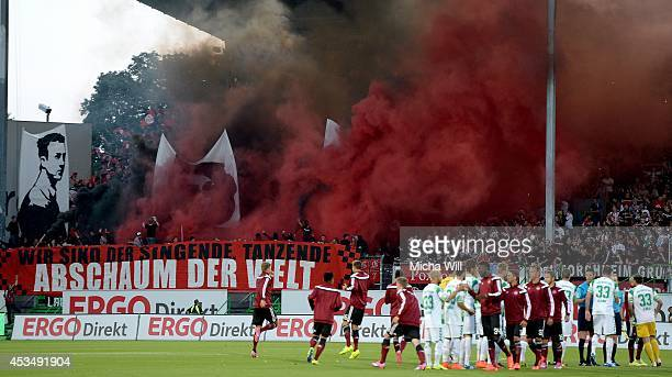 Nuernberg fans put up smokescreens during the Bundesliga match between Greuther Fuerth and 1 FC Nuernberg at TrolliArena on August 11 2014 in Fuerth...