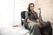 Nugeen 45 is a PKK fighter who took part in the recent battle for Makhmour She is seen siting in a chair at the PKK base in Makhmour Makhmour is a...