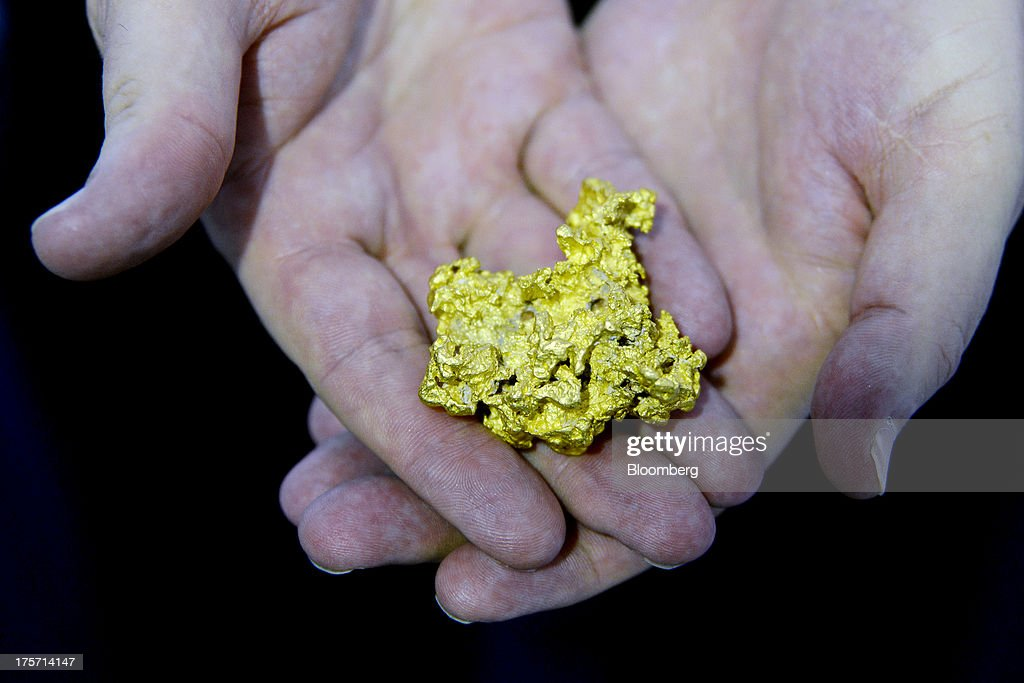 A nugget of gold is arranged for a photograph at the Phoenix Gold Ltd booth during the Diggers and Dealers mining forum in Kalgoorlie Australia on...