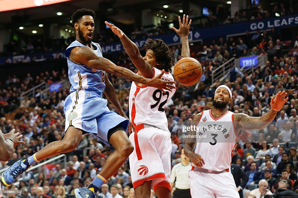 Nuggets' guard Will Barton gets the ball past Raptors' centre Lucas Nogueira and forward James Johnson in first half action Toronto Raptors vs...