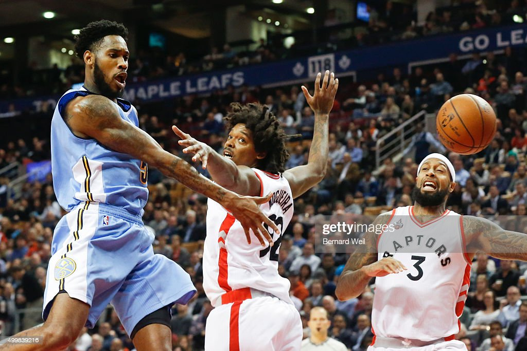 Nuggets' guard Will Barton gets the ball past Raptors' centre Lucas Nogueira and forward James Johnson in first half action Toronto Raptors vs Denver...
