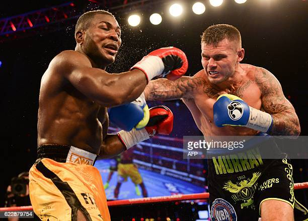 TOPSHOT Nuhu Lawal of Germany absorbs a right from Martin Murray of Great Britain during their WBA Continental Super Middleweight fight on November...