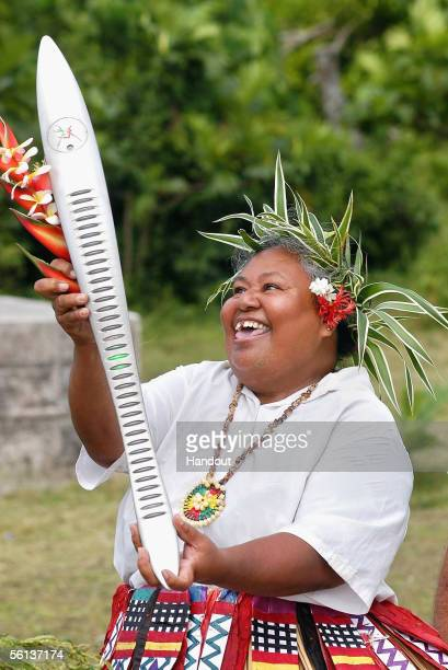 Nuku Sione carries the Melbourne 2006 Queen's Baton during the Nuie leg of the baton's journey November 10 2005 in Niue The Baton arrives in...