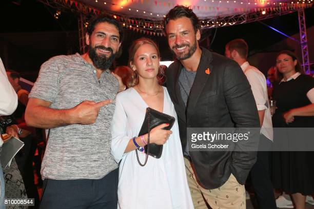 Numan Acar and Emely Luca and her father Stephan Luca during the 50th anniversary celebration of Marc O'Polo at its headquarters on July 6 2017 in...