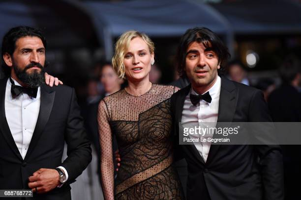 Numan Acar Diane Kruger and director Faith Akin attend the 'In The Fade ' screening during the 70th annual Cannes Film Festival at Palais des...