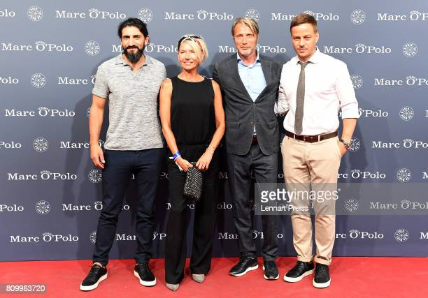 Numan Acar Hanne Jacobsen and her husband Mads Mikkelsen and Tom Wlaschiha arrive for the 50th anniversary celebration of Marc O'Polo at its...