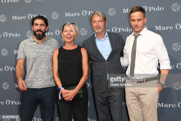 Numan Acar Mads Mikkelsen and his wife Hanne Jacobsen and Tom Wlaschiha during the 50th anniversary celebration of Marc O'Polo at its headquarters on...