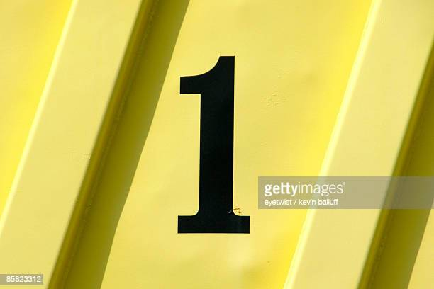 Number 1 on a yellow panel