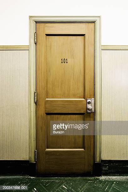 Number '101' sign on door