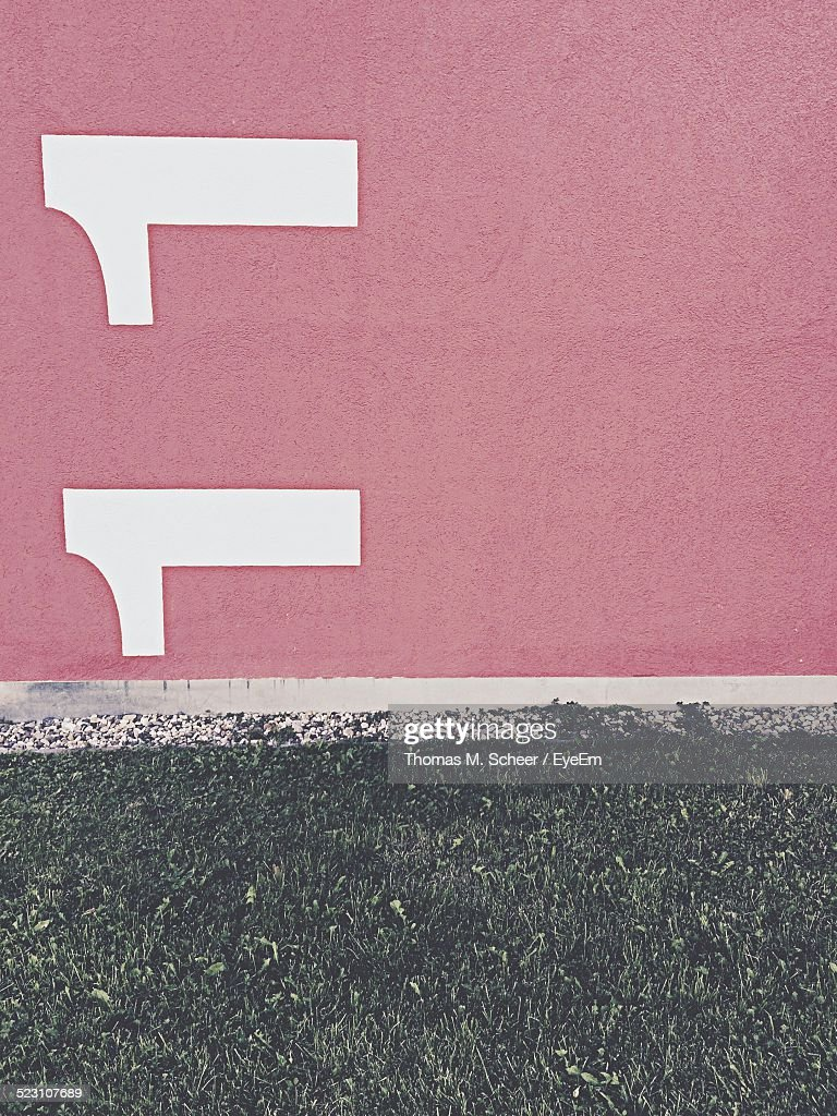 Number 11 Painted On Red Wall