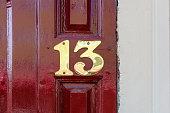 Brass house number thirteen.