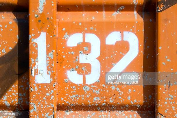 Number 132 on a Orange Wall