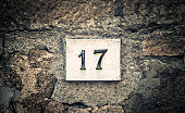 Number 17 road sign in a town in Tuscany.