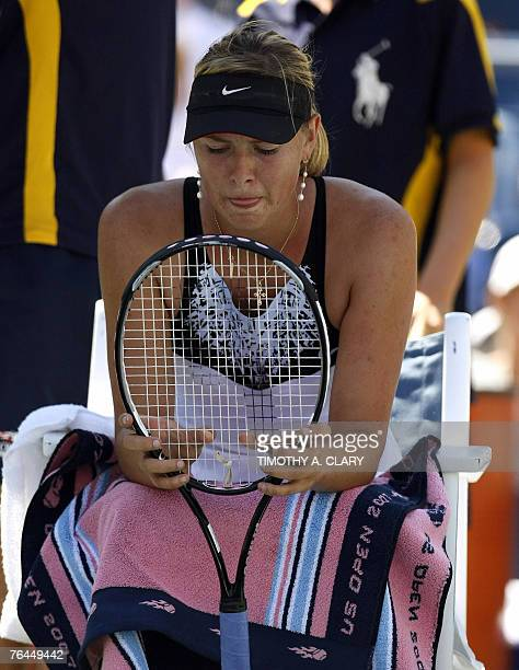 Number 2 seed Maria Sharapova of Russia looks at her racket during her match against Number 30 seed Agnieszka Radwanska of Poland during their 3rd...