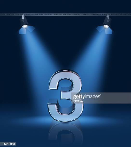 3D number 3 lit up with blue lights