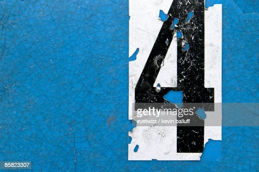 Number 4 on a blue panel