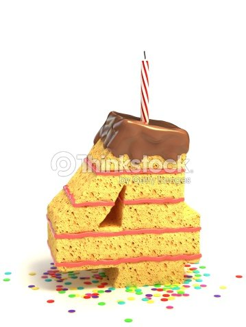 Number 4 Shaped Chocolate Birthday Cake With Lit Candle Stock Photo
