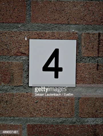 Number 4 signboard on brick wall