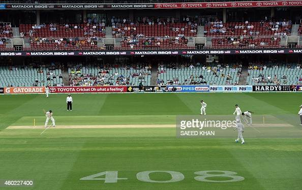 A number 408 is seen on the ground as a tribute to the late Phillip Hughes who was Australia's 408th Test cricket player as Australia's batsman Steve...