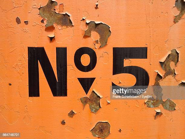 Number 5 On Weathered Wall