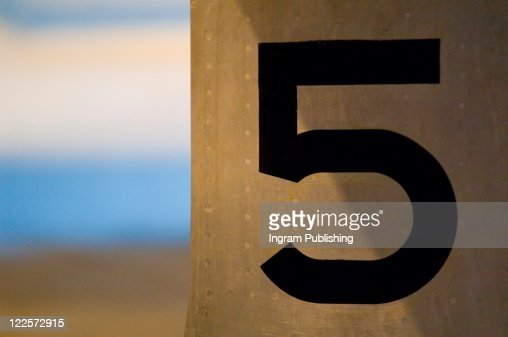 Number 5 painted on metal surface. : Stock-Foto
