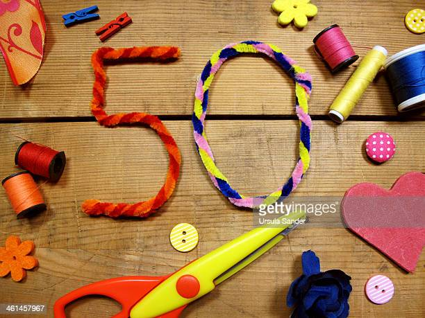 Number 50 formed out of colorful Pipe Cleaner