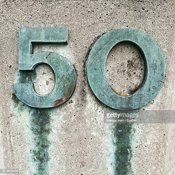 Number 50 On Concrete Wall