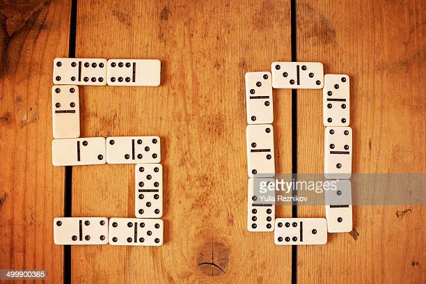 Number 50 with white domino on the wood background