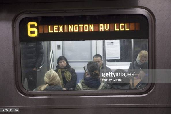 A Number 6 Lexington Avenue line local subway train gets ready to depart Union Square station Manhattan New York City United States