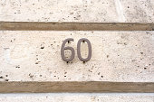 Metal house number sixty