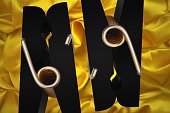 Number 69 Clothes pegs in symmetry on gilt satin sheet