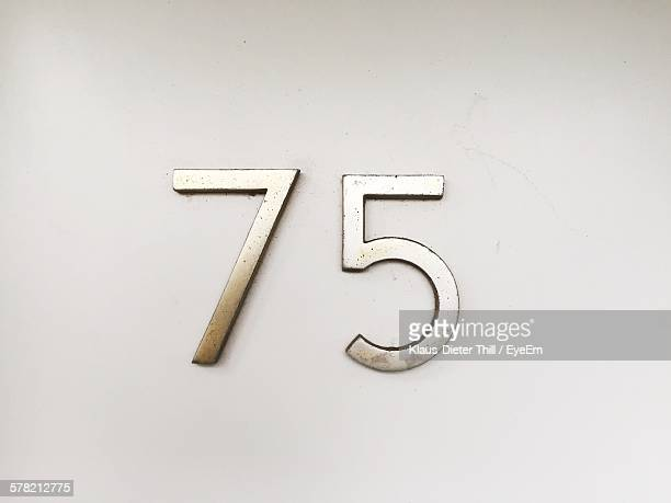 Number 75 On White Wall