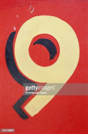 Number '9' painted on wall, close-up