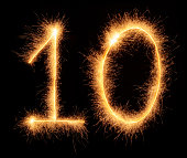 '10' number drawn with bengali sparkles isolated on black background