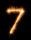 '7' number drawn with bengali sparkles isolated on black background