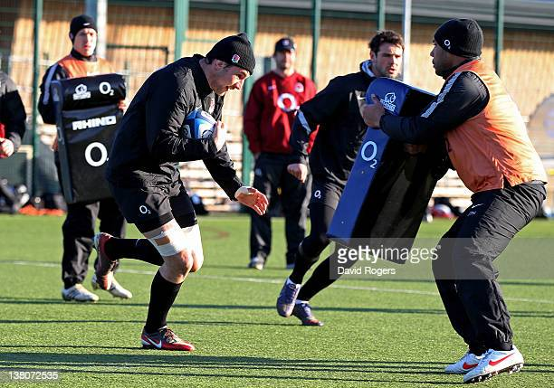Number eight Phil Dowson takes the ball into contact during the England training session at Surrey Sports Park on February 2 2012 in Guildford England