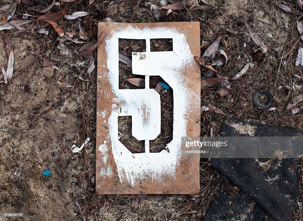 Number five on the old metal stencil : Stock Photo