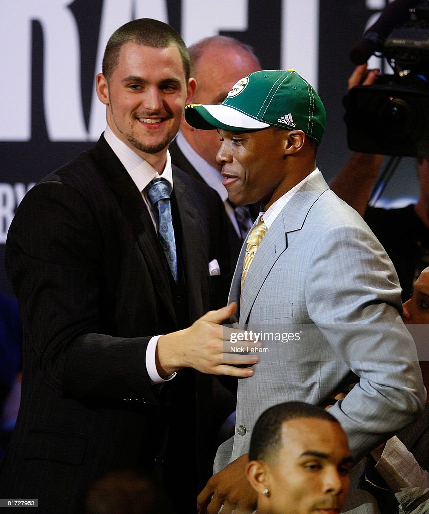 Number four draft pick for the Seattle SuperSonics, Russell Westbrook is congratulated by the fifth pick for the Memphis Grizzlies, Kevin Love during the 2008 NBA Draft at the Wamu Theatre at Madison Square Garden June 26, 2008 in New York City.