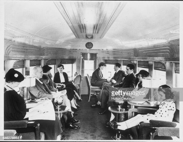 A number of passengers in the observation end of one of the lounge cars on the streamlined Illinois Central System diesel train called the 'Green...