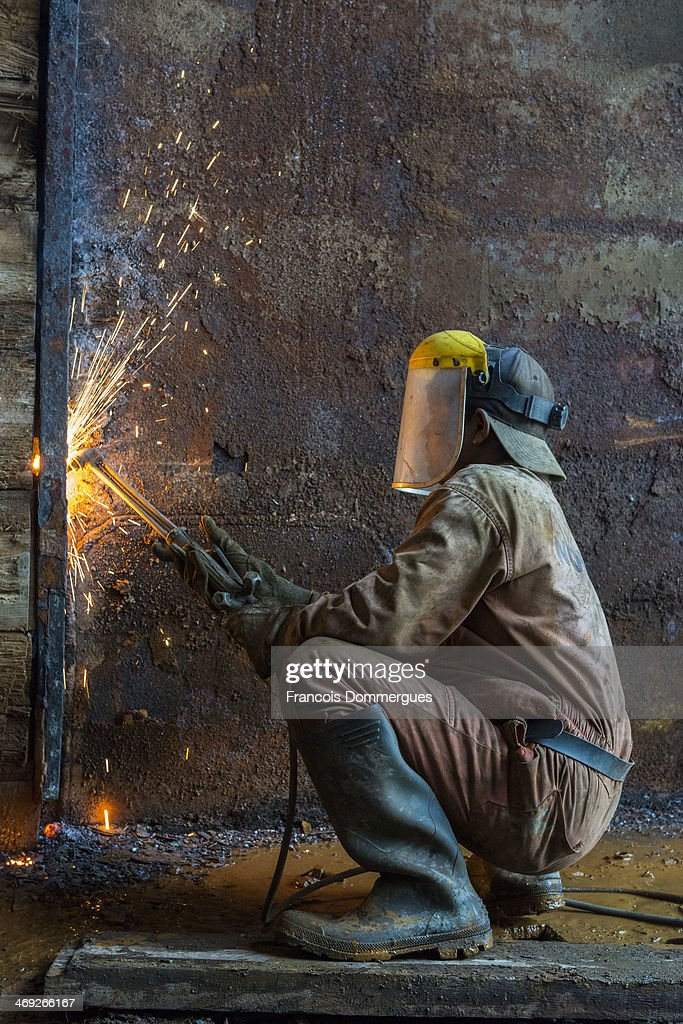 CONTENT] A number of ship breaking yards are located a few kilometers North of Chittagong on the road to Dhaka Workers dismantle ships right on the...