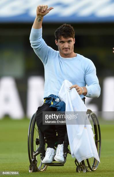 Number one wheelchair tennis player Gustavo Fernandez of Argentina receives an ovation before a match between Boca Juniors and Godoy Cruz as part of...