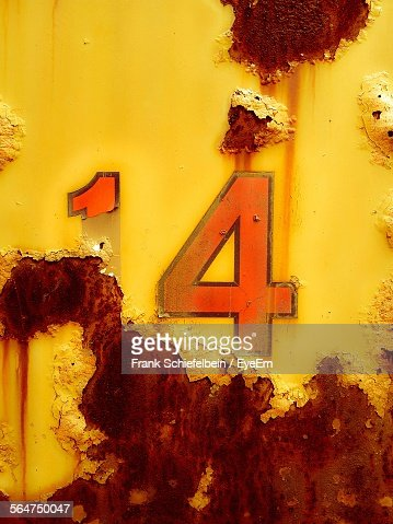 Number Painted On Rusty Metal Wall