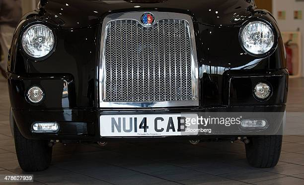 A 2014 number registration plate sits on the bumper of a new black TX4 Euro 5 London taxi cab produced by the London Taxi Company a unit of Zhejiang...