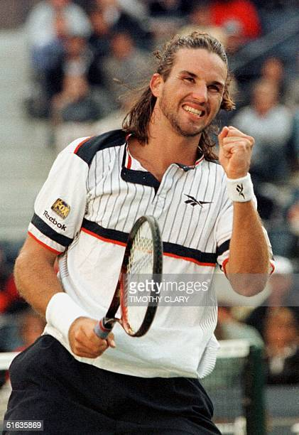 Number three seed Patrick Rafter of Australia celebrates during his victory over number 12 seed Jonas Bjorkman of Sweden 09 September at the US Open...