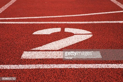 Number two. Big white track number on red rubber racetrack : Stock Photo