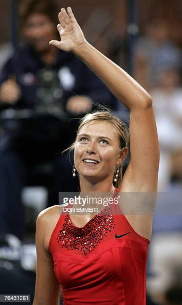 Number two seeded Maria Sharapova of Russia waves to the crowd after defeating Casey Dellacqua of Australia 30 August 2007 at the US Open in Flushing...
